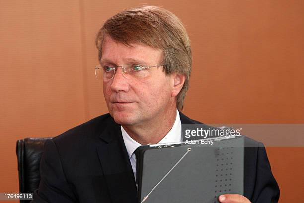 German Chancellery Chief of Staff Ronald Pofalla arrives for the weekly German federal Cabinet meeting on August 14 2013 in Berlin Germany Pofalla...