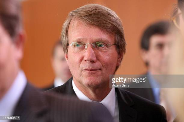 German Chancellery Chief of Staff Ronald Pofalla arrives for the weekly federal Cabinet meeting on August 21 2013 in Berlin Germany High on the...