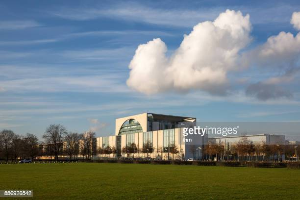 German chancellery with a large cloud in the sky (Berlin, Germany)