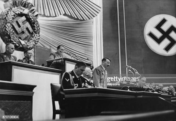 German Chancellor Adolf Hitler addresses the Reichstag in Berlin 28th April 1939 Behind him is Hermann Goering President of the Reichstag