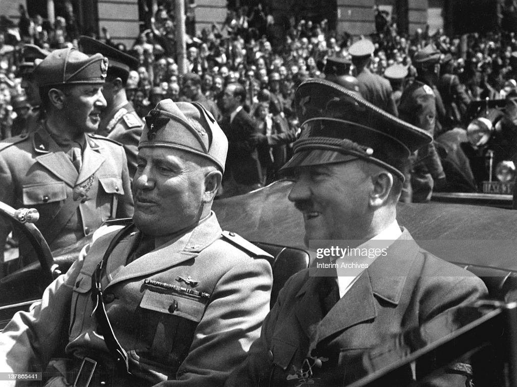 German chancellor Adolf Hitler (right) and Italian dictator Benito Mussolini (left) are seen riding along the streets of Munich, Germany, June 1940.