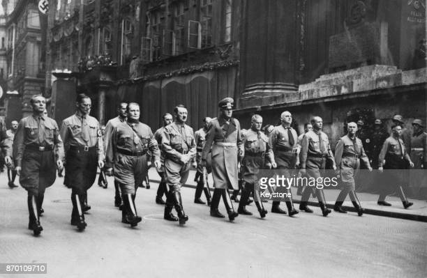 German Chancellor Adolf Hitler Hermann Goering and Werner von Blomberg lead a procession of Nazis to the Munich Burgerbrau Cellar to commemorate the...