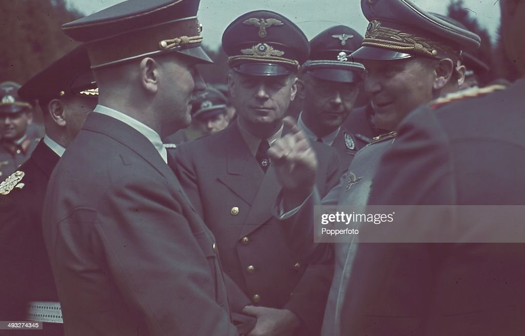 German Chancellor <a gi-track='captionPersonalityLinkClicked' href=/galleries/search?phrase=Adolf+Hitler&family=editorial&specificpeople=90219 ng-click='$event.stopPropagation()'>Adolf Hitler</a> (1889-1945) in conversation with Foreign Minister Joachim von Ribbentrop (1893-1946), <a gi-track='captionPersonalityLinkClicked' href=/galleries/search?phrase=Heinrich+Himmler&family=editorial&specificpeople=93504 ng-click='$event.stopPropagation()'>Heinrich Himmler</a> (1900-1945) and <a gi-track='captionPersonalityLinkClicked' href=/galleries/search?phrase=Hermann+Goering&family=editorial&specificpeople=93518 ng-click='$event.stopPropagation()'>Hermann Goering</a> (1893-1946) on right. Grand Admiral Erich Raeder (1876-1960) is partly obscured by Hitler.