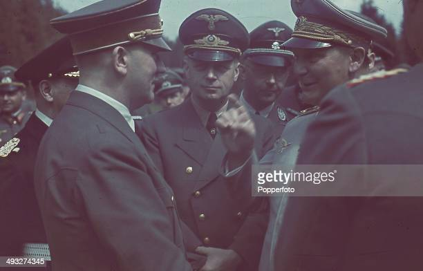 German Chancellor Adolf Hitler in conversation with Foreign Minister Joachim von Ribbentrop Heinrich Himmler and Hermann Goering on right Grand...