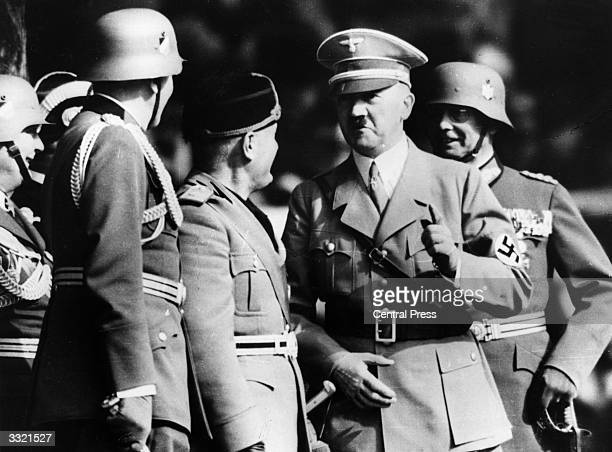 German chancellor Adolf Hitler in conversation with Italian dictator Benito Mussolini during Mussolini's visit to Germany