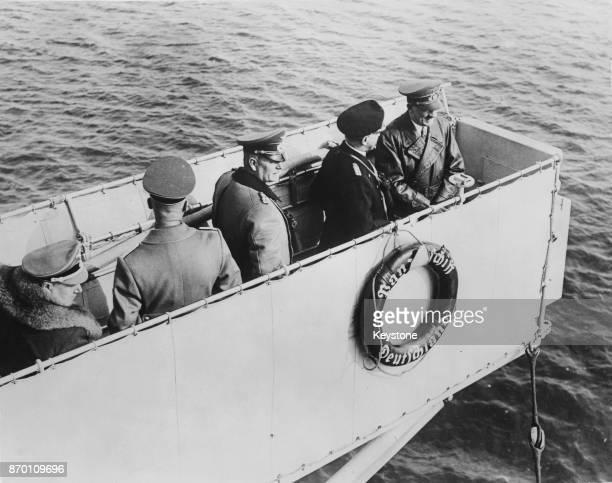 German Chancellor Adolf Hitler jokes with Admiral Erich Raeder on the bridge of the cruiser 'Deutschland' while returning from Memel March 1939 In...