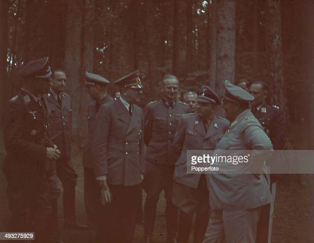 German Chancellor Adolf Hitler pictured with various Generals and high ranking officials including Hermann Goering on far right and Martin Bormann...