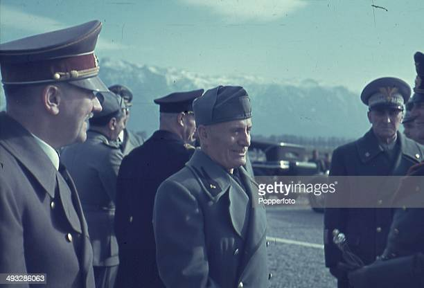 German Chancellor Adolf Hitler talks with Italian Prime Minister Benito Mussolini and Italian Marshal Rodolfo Graziani during Hitler's visit to the...