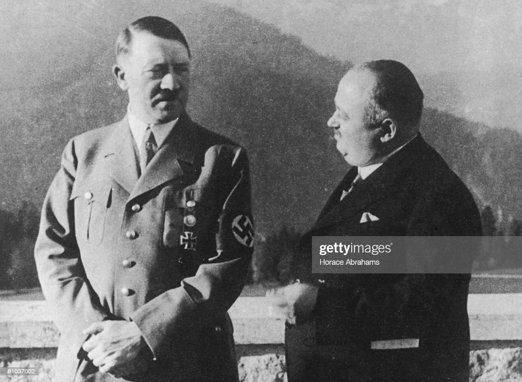 German Chancellor Adolf Hitler (1889 - 1945) with his personal butler Kannenberg in the Berchtesgaden mountains, circa 1935.