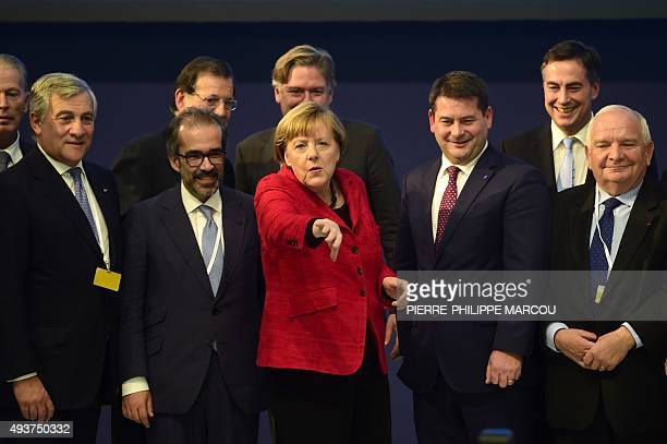 German Chancellor and CDU federal chairwoman Angela Merkel gestures during a family photo with newly elected French President of European People's...