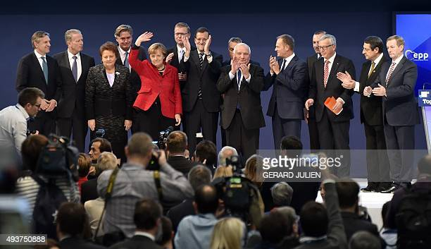 German Chancellor and CDU federal chairwoman Angela Merkel gestures during a family photo with Spanish Prime Minister and leader of the rightwing PP...