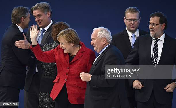 German Chancellor and CDU federal chairwoman Angela Merkel waves after a family photo with Spanish Prime Minister and leader of the rightwing PP...