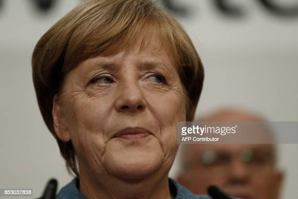 German Chancellor and CDU party leader Angela Merkel addresses supporters after exit poll results were broadcasted on public television at an...