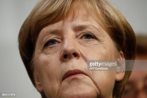 German Chancellor and CDU party leader Angela Merkel addresses an election night event at the party's headquarters in Berlin during the general...