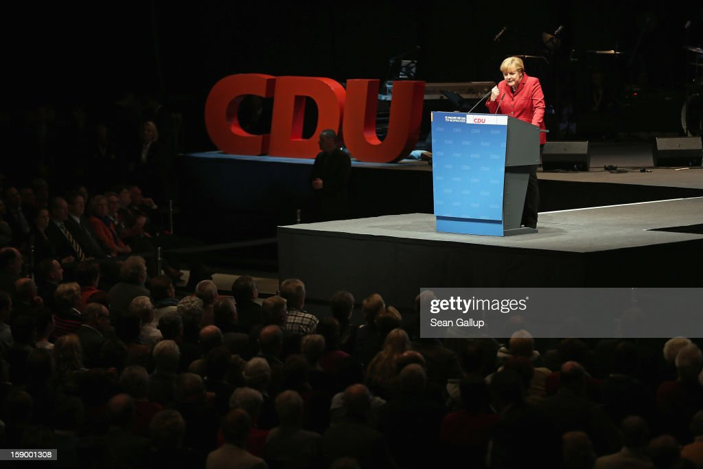 German Chancellor and Chairwoman of the German Christian Democrats (CDU) <a gi-track='captionPersonalityLinkClicked' href=/galleries/search?phrase=Angela+Merkel&family=editorial&specificpeople=202161 ng-click='$event.stopPropagation()'>Angela Merkel</a> speaks to supporters at a CDU Lower Saxony state election rally on January 5, 2013 in Braunschweig, Germany. Lower Saxony is holding state elections on January 20 and many analysts see the election as a bellwether for national elections scheduled to take place later this year.