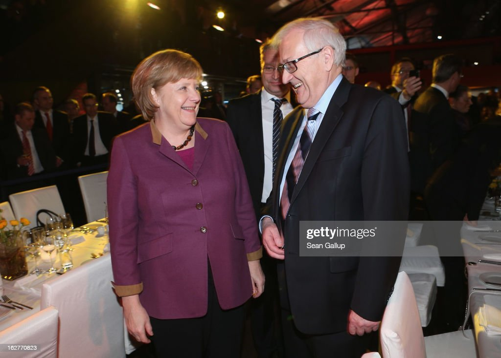 German Chancellor and Chairwoman of the German Christian Democrats (CDU) <a gi-track='captionPersonalityLinkClicked' href=/galleries/search?phrase=Angela+Merkel&family=editorial&specificpeople=202161 ng-click='$event.stopPropagation()'>Angela Merkel</a> and <a gi-track='captionPersonalityLinkClicked' href=/galleries/search?phrase=Rainer+Bruederle&family=editorial&specificpeople=2146238 ng-click='$event.stopPropagation()'>Rainer Bruederle</a> of the German Free Democrats (FDP) attend FDP Chairman Philipp Roesler's 40th birthday celebration on February 26, 2013 in Berlin, Germany. The FDP and CDU are the current German government coalition, though the FDP has faced a very challenging last 18 months that has brought the party to its lowest popularity ratings in decades. Germany faces federal elections in September.