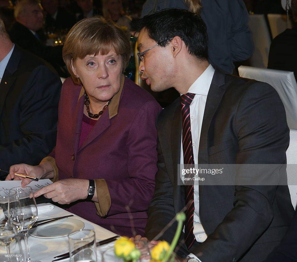 German Chancellor and Chairwoman of the German Christian Democrats (CDU) <a gi-track='captionPersonalityLinkClicked' href=/galleries/search?phrase=Angela+Merkel&family=editorial&specificpeople=202161 ng-click='$event.stopPropagation()'>Angela Merkel</a> and <a gi-track='captionPersonalityLinkClicked' href=/galleries/search?phrase=Philipp+Roesler&family=editorial&specificpeople=4838791 ng-click='$event.stopPropagation()'>Philipp Roesler</a>, Vice Chancellor and Chairman of the German Free Democrats (FDP), attend Roesler's 40th birthday celebration on February 26, 2013 in Berlin, Germany. The FDP and CDU are the current German government coalition, though the FDP has faced a very challenging last 18 months that has brought the party to its lowest popularity ratings in decades. Germany faces federal elections in September.