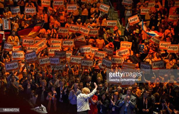 German Chancellor and Chairwoman of the German Christian Democrats Angela Merkel waves at the first election campaign rally in the final phase of...