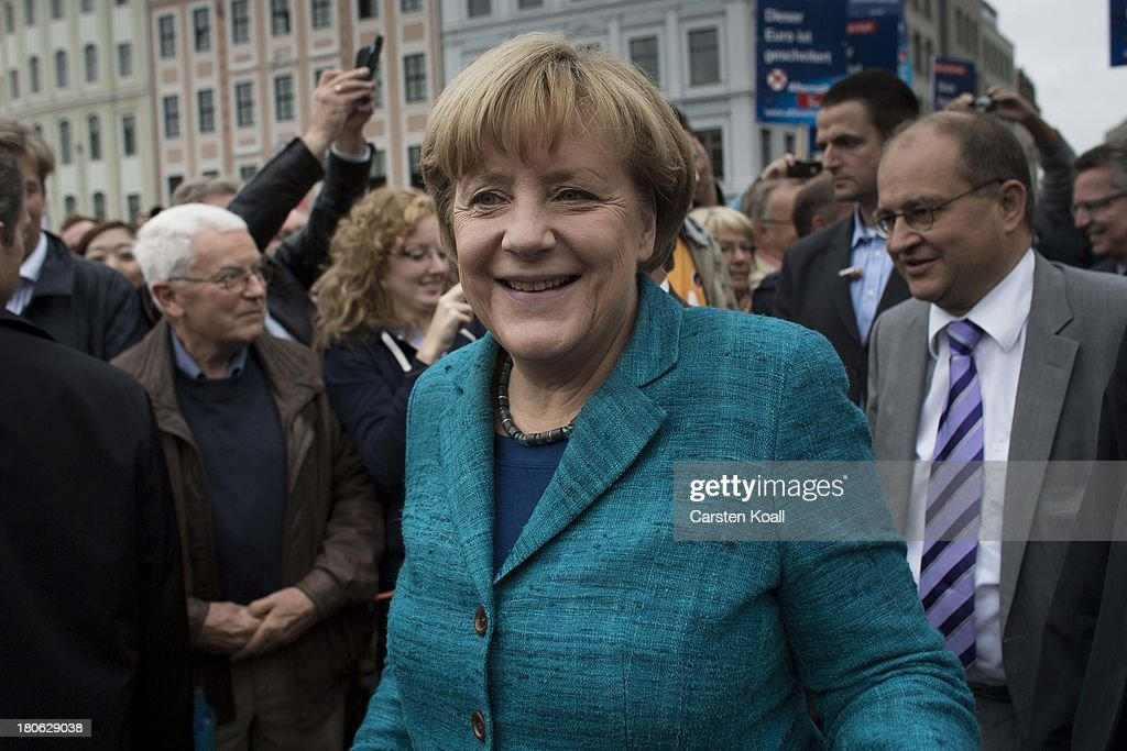 German Chancellor and Chairwoman of the German Christian Democrats (CDU) <a gi-track='captionPersonalityLinkClicked' href=/galleries/search?phrase=Angela+Merkel&family=editorial&specificpeople=202161 ng-click='$event.stopPropagation()'>Angela Merkel</a> is welcomed by supporters during a CDU election campaign rally on September 15, 2013 in Dresden, Germany. Merkel has a strong lead over her political rivals and the CDU is expected to win federal elections scheduled for September 22