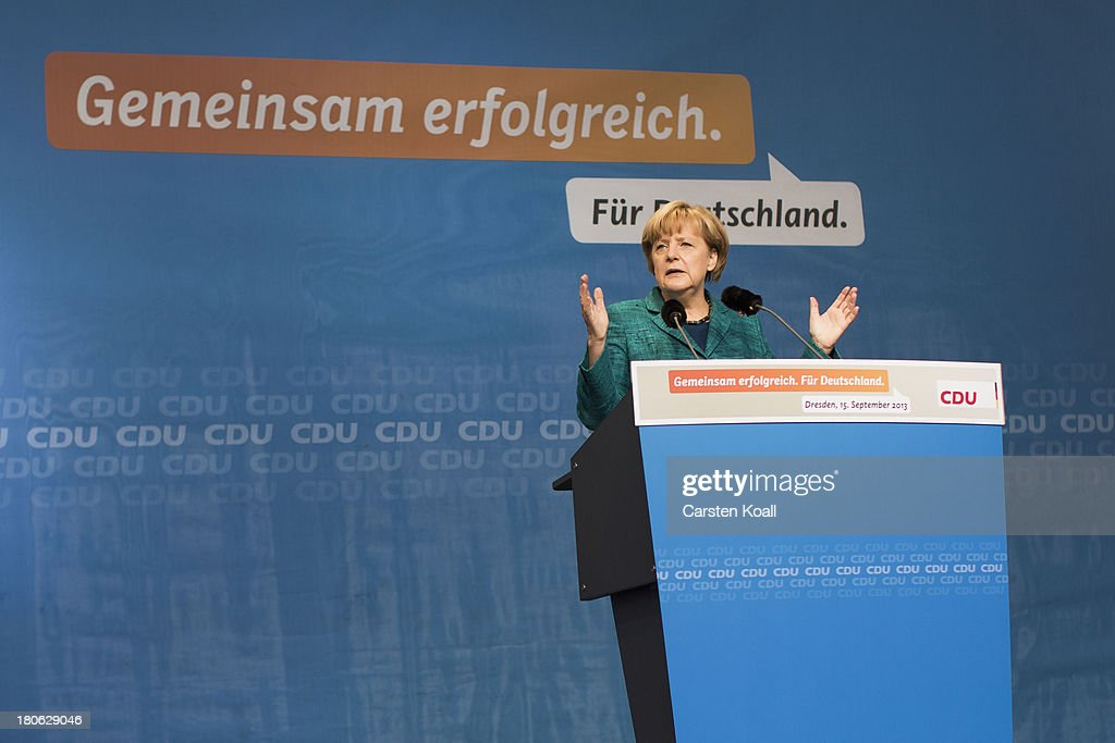 German Chancellor and Chairwoman of the German Christian Democrats (CDU) <a gi-track='captionPersonalityLinkClicked' href=/galleries/search?phrase=Angela+Merkel&family=editorial&specificpeople=202161 ng-click='$event.stopPropagation()'>Angela Merkel</a> speaks during a CDU election campaign rally on September 15, 2013 in Dresden, Germany. Merkel has a strong lead over her political rivals and the CDU is expected to win federal elections scheduled for September 22