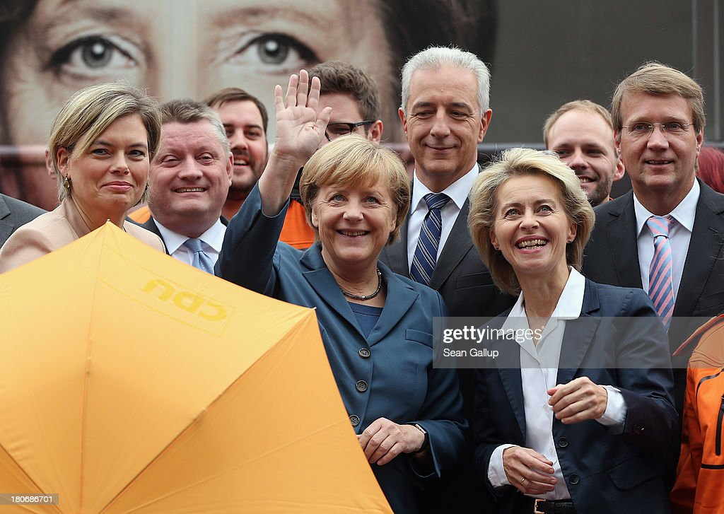German Chancellor and Chairwoman of the German Christian Democrats (CDU) Angela Merkel waves while standing with leading CDU board members outside CDU headquarters on September 16, 2013 in Berlin, Germany. Germany faces federal elections on September 22 and so far the CDU has a strong lead in polls over the opposition.
