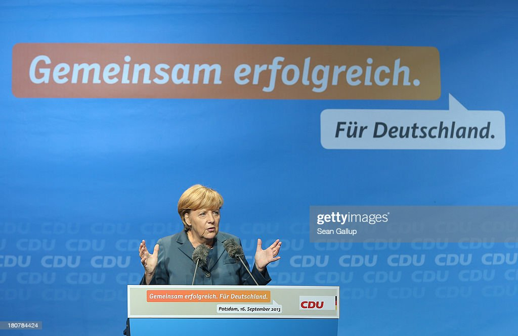German Chancellor and Chairwoman of the German Christian Democrats (CDU) <a gi-track='captionPersonalityLinkClicked' href=/galleries/search?phrase=Angela+Merkel&family=editorial&specificpeople=202161 ng-click='$event.stopPropagation()'>Angela Merkel</a> speaks at a CDU election rally on September 16, 2013 in Potsdam, Germany. Germany faces federal elections on September 22 and so far the CDU has a strong lead in polls over the opposition.