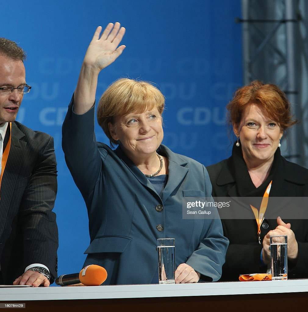 German Chancellor and Chairwoman of the German Christian Democrats (CDU) <a gi-track='captionPersonalityLinkClicked' href=/galleries/search?phrase=Angela+Merkel&family=editorial&specificpeople=202161 ng-click='$event.stopPropagation()'>Angela Merkel</a> waves after she spoke at a CDU election rally on September 16, 2013 in Potsdam, Germany. Germany faces federal elections on September 22 and so far the CDU has a strong lead in polls over the opposition.