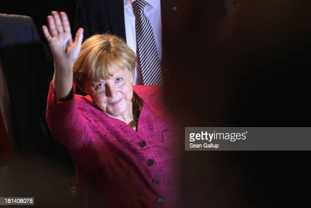 German Chancellor and Chairwoman of the German Christian Democrats Angela Merkel waves as she departs after speaking at a CDU election rally the day...