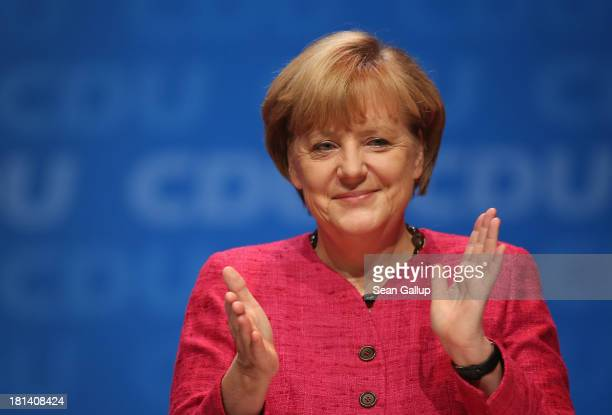 German Chancellor and Chairwoman of the German Christian Democrats Angela Merkel speaks to supporters at a CDU election rally the day before federal...