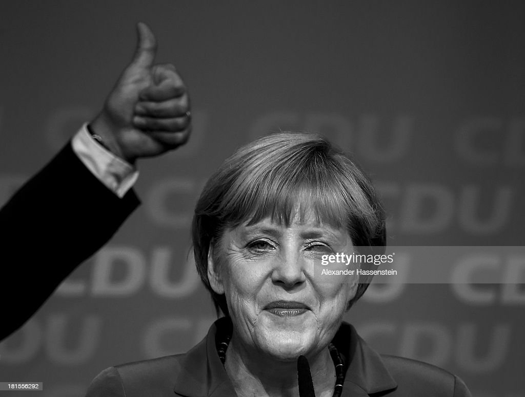 German Chancellor and Chairwoman of the German Christian Democrats (CDU) <a gi-track='captionPersonalityLinkClicked' href=/galleries/search?phrase=Angela+Merkel&family=editorial&specificpeople=202161 ng-click='$event.stopPropagation()'>Angela Merkel</a>, speaks to supporters at CDU headquarter Konrad-Adenauer-Haus after initial results give the CDU 42% of votes cast in the Germany election on September 22, 2013 in Berlin, Germany.