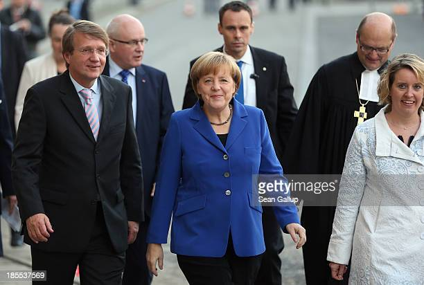 German Chancellor and Chairwoman of the German Christian Democrats Angela Merkel and Chancellor Minister Ronald Pofalla arrive for a religious...