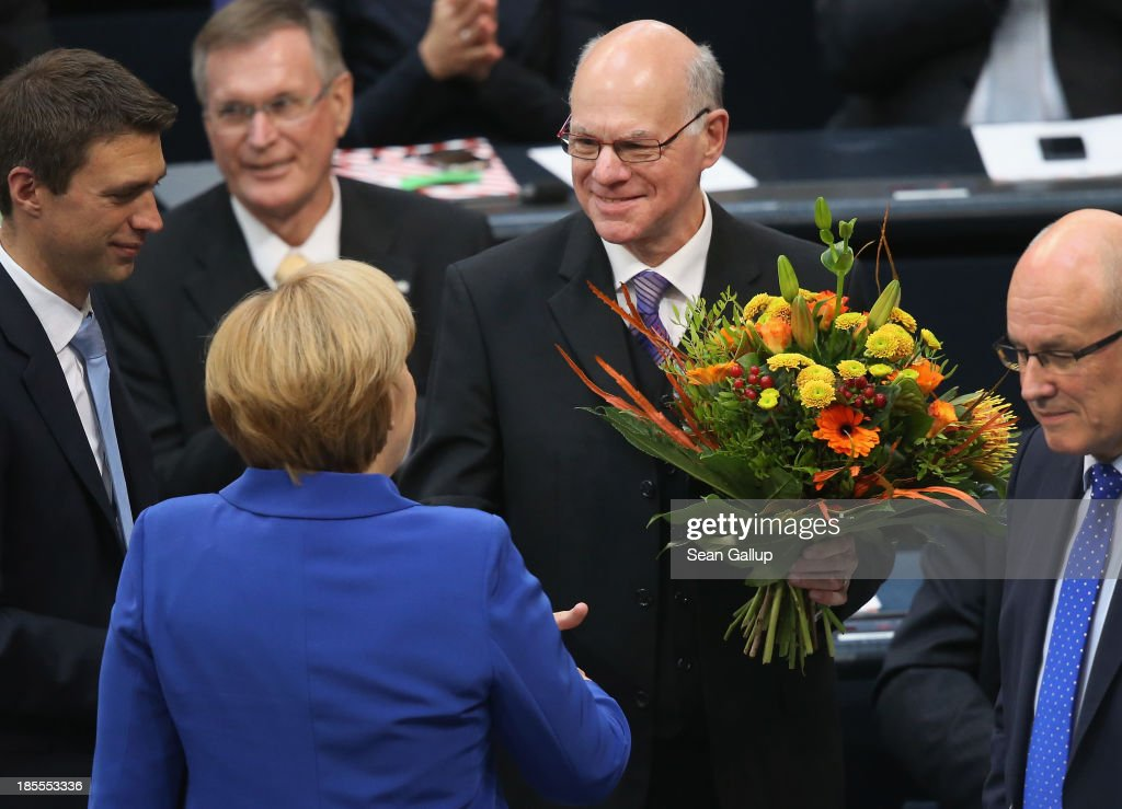 German Chancellor and Chairwoman of the German Christian Democrats (CDU) <a gi-track='captionPersonalityLinkClicked' href=/galleries/search?phrase=Angela+Merkel&family=editorial&specificpeople=202161 ng-click='$event.stopPropagation()'>Angela Merkel</a> congratulates <a gi-track='captionPersonalityLinkClicked' href=/galleries/search?phrase=Norbert+Lammert&family=editorial&specificpeople=575522 ng-click='$event.stopPropagation()'>Norbert Lammert</a> after he was elected Bundestag president at the first session of the new Bundestag following recent nationwide elections on October 22, 2013 in Berlin, Germany. The session heralds the beginning of the 18th legislative period, though the German government remains in transition as the Christian Democrats (CDU) and German Social Democrats (SPD) are still in the process of coalition negotiations whose outcome remains uncertain.
