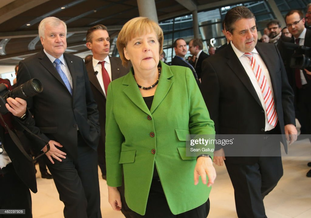 German Chancellor and Chairwoman of the German Christian Democrats (CDU) <a gi-track='captionPersonalityLinkClicked' href=/galleries/search?phrase=Angela+Merkel&family=editorial&specificpeople=202161 ng-click='$event.stopPropagation()'>Angela Merkel</a>, Chairman of the German Social Democrats (SPD) <a gi-track='captionPersonalityLinkClicked' href=/galleries/search?phrase=Sigmar+Gabriel&family=editorial&specificpeople=543927 ng-click='$event.stopPropagation()'>Sigmar Gabriel</a> (R) and Chairman of the Bavarian Christian Democrats (CSU) <a gi-track='captionPersonalityLinkClicked' href=/galleries/search?phrase=Horst+Seehofer&family=editorial&specificpeople=4273631 ng-click='$event.stopPropagation()'>Horst Seehofer</a> depart after signing the three parties' coalition contract at the Bundestag on November 27, 2013 in Berlin, Germany. The three parties worked their way through arduous negotiations on policy issues that concluded with a 17-hour overnight session last night in order to hammer out the final details that will make a new German coalition government possible. The agreement still requires approval by party delegates, which especially in the case of the SPD is uncertain.