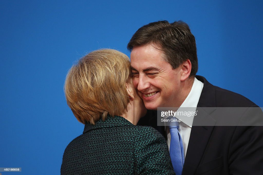 German Chancellor and Chairwoman of the German Christian Democrats (CDU) Angela Merkel embraces fellow party member <a gi-track='captionPersonalityLinkClicked' href=/galleries/search?phrase=David+McAllister+-+Pol%C3%ADtico+alem%C3%A1n&family=editorial&specificpeople=8753646 ng-click='$event.stopPropagation()'>David McAllister</a> at the annual CDU party congress on December 9, 2014 in Cologne, Germany. The CDU is the senior partner in Germany's ruling government coalition.