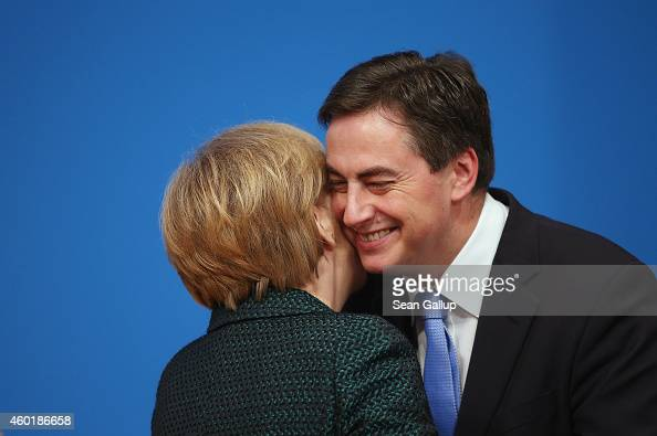 German Chancellor and Chairwoman of the German Christian Democrats Angela Merkel embraces fellow party member David McAllister at the annual CDU...