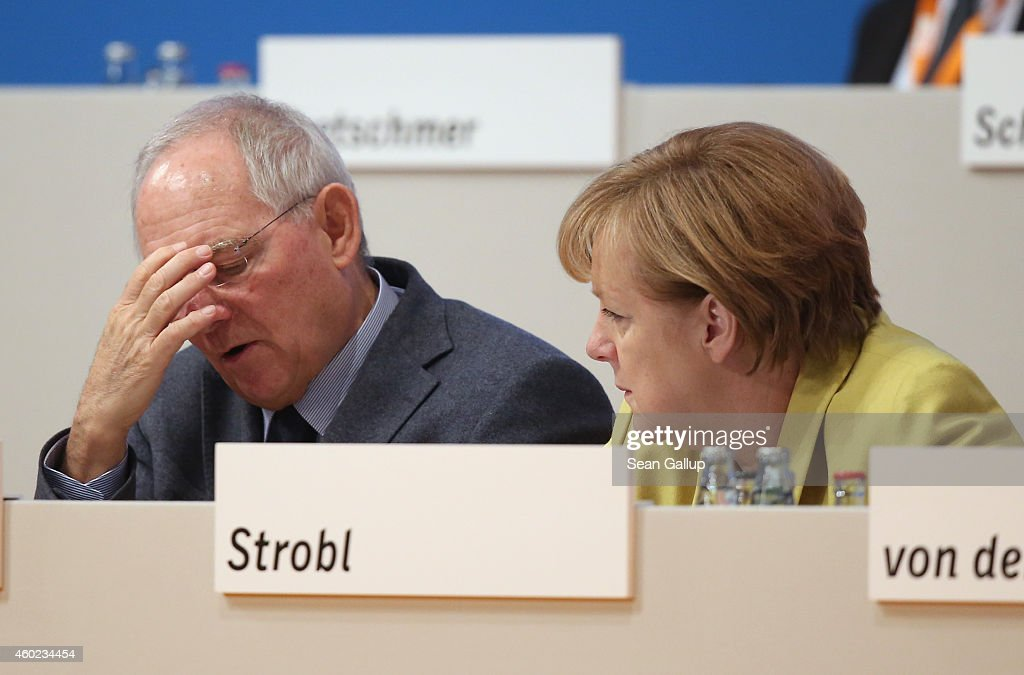 German Chancellor and Chairwoman of the German Christian Democrats (CDU) <a gi-track='captionPersonalityLinkClicked' href=/galleries/search?phrase=Angela+Merkel&family=editorial&specificpeople=202161 ng-click='$event.stopPropagation()'>Angela Merkel</a> (R) and German Finance Minister Wolfgang Schaeuble chat at the annual CDU party congress on December 10, 2014 in Cologne, Germany. The CDU is the senior partner in Germany's ruling government coalition and yesterday delegates re-elected Merkel as party chairwoman with 96.7% of votes.