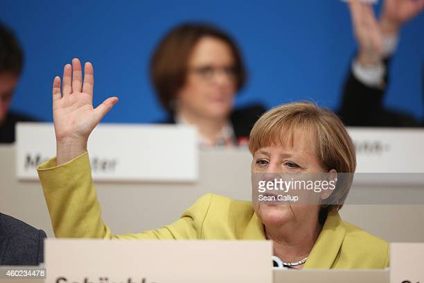 German Chancellor and Chairwoman of the German Christian Democrats Angela Merkel votes on a measure at the annual CDU party congress on December 10...