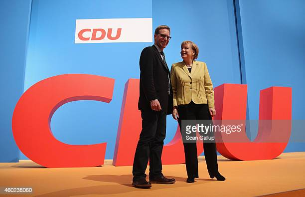 German Chancellor and Chairwoman of the German Christian Democrats Angela Merkel poses for a photo with CDU member Marc Henrichmann at the annual CDU...