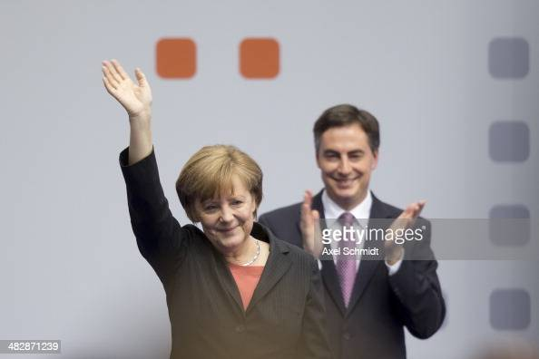 German Chancellor and Chairwoman of the German Christian Democrats Angela Merkel waves next to David McAllister top candidate of the CDU for European...