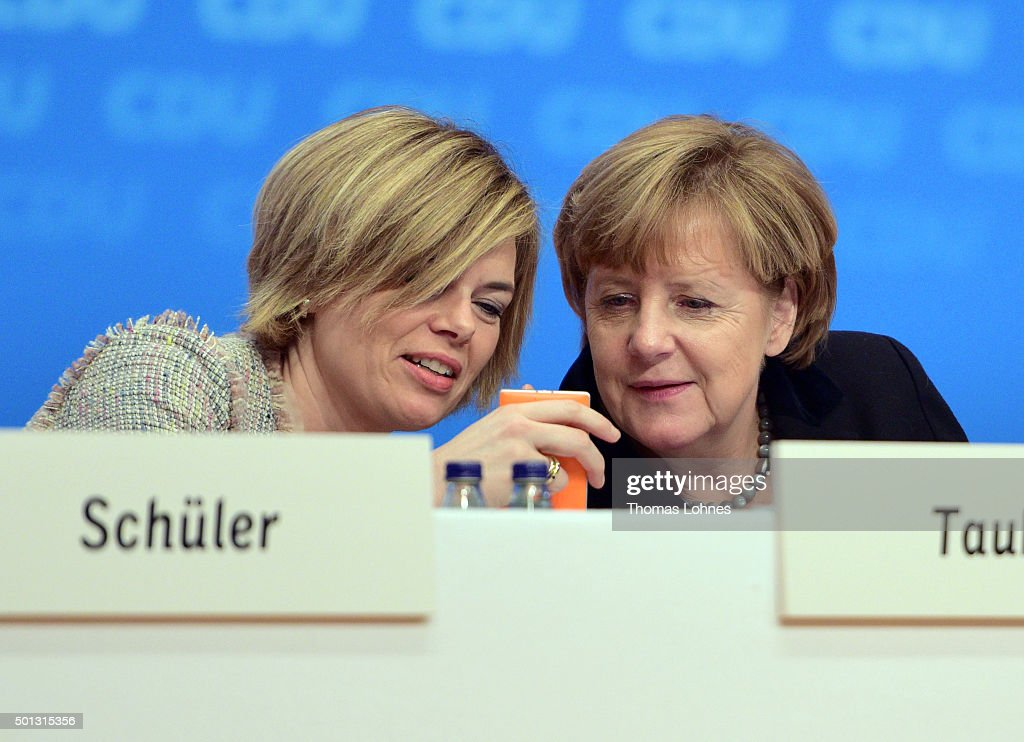 German Chancellor and Chairwoman of the German Christian Democrats (CDU) <a gi-track='captionPersonalityLinkClicked' href=/galleries/search?phrase=Angela+Merkel&family=editorial&specificpeople=202161 ng-click='$event.stopPropagation()'>Angela Merkel</a> (R) looks at the mobile phone of the deputy chairwoman of CDU party <a gi-track='captionPersonalityLinkClicked' href=/galleries/search?phrase=Julia+Kloeckner&family=editorial&specificpeople=6902085 ng-click='$event.stopPropagation()'>Julia Kloeckner</a> (L) at the annual CDU federal congress on December 14, 2015 in Karlsruhe, Germany. The CDU is meeting following a dramatic year in which Germany admitted approximately one million migrants and refugees under an open-door policy spearheaded by Merkel. A growing number of CDU members think Merkel has gone too far and see the influx as a burdensome challenge that should have been capped sooner.