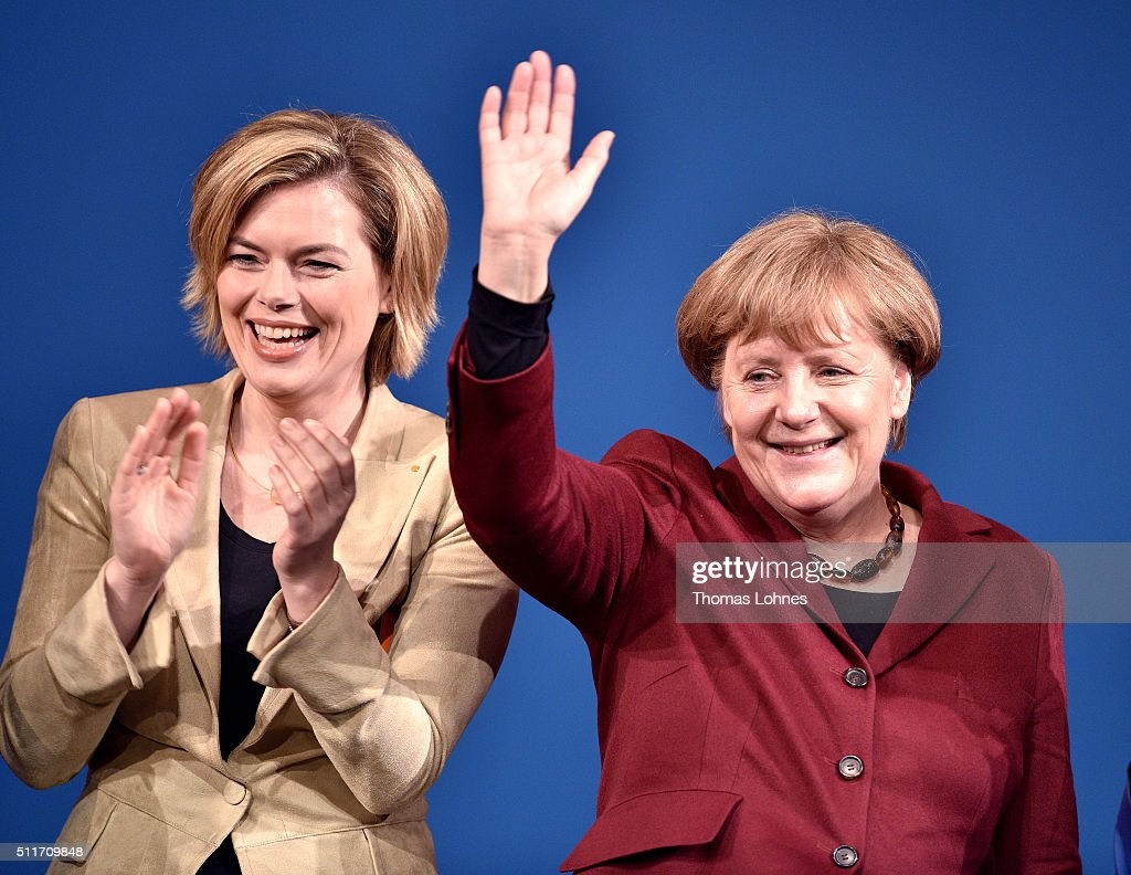 German Chancellor and Chairwoman of the German Christian Democrats (CDU) <a gi-track='captionPersonalityLinkClicked' href=/galleries/search?phrase=Angela+Merkel&family=editorial&specificpeople=202161 ng-click='$event.stopPropagation()'>Angela Merkel</a> (R) and CDU lead candidate for Rhineland-Palatinate <a gi-track='captionPersonalityLinkClicked' href=/galleries/search?phrase=Julia+Kloeckner&family=editorial&specificpeople=6902085 ng-click='$event.stopPropagation()'>Julia Kloeckner</a> (L) greet supporters at an election campaign rally on February 22, 2016 in Landau in der Pfalz, Germany. State elections scheduled for March 13 in three German states: Rhineland-Palatinate, Saxony-Anhalt and Baden-Wuerttemberg, will be a crucial test-case for German Chancellor and Chairwoman of the German Christian Democrats (CDU) <a gi-track='captionPersonalityLinkClicked' href=/galleries/search?phrase=Angela+Merkel&family=editorial&specificpeople=202161 ng-click='$event.stopPropagation()'>Angela Merkel</a>, who has come under increasing pressure over her liberal immigration policy towards migrants and refugees. The right-wing Alternative fuer Deutschland (AfD), with campaign rhetoric aimed at Germans who are uneasy with so many newcomers, has solid polling numbers and will almost certainly win seats in all three state parliaments.
