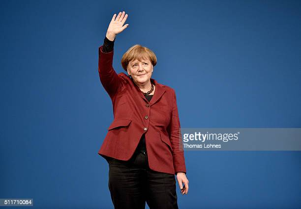 German Chancellor and Chairwoman of the German Christian Democrats Angela Merkel greets supporters at an election campaign rally for the CDU lead...