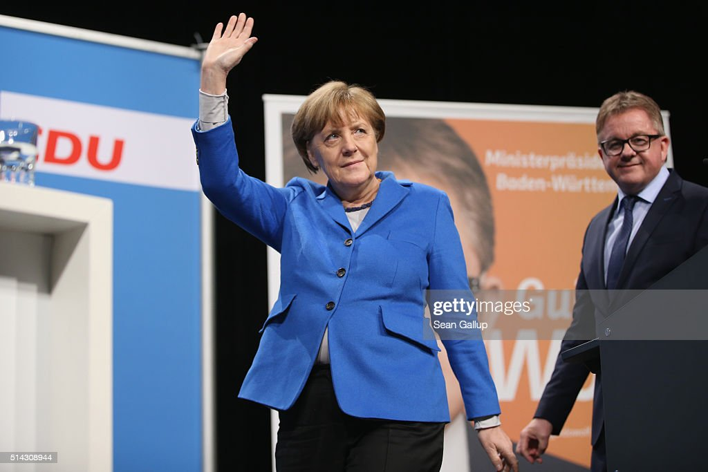 German Chancellor and Chairwoman of the German Christian Democrats Angela Merkel and local CDU lead candidate Guido Wolf greet supporters at the...