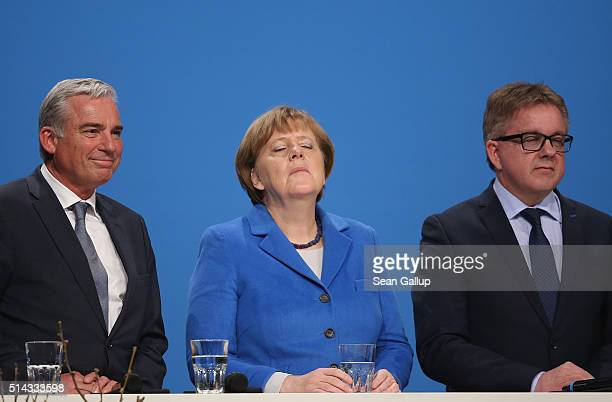German Chancellor and Chairwoman of the German Christian Democrats Angela Merkel closes her eyes for a moment while attending a CDU campaign rally...