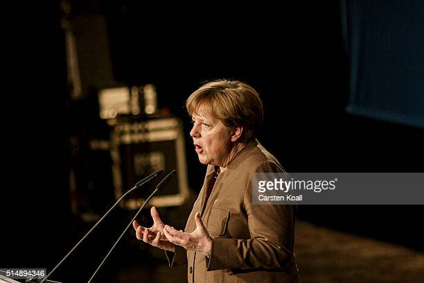 German Chancellor and Chairwoman of the German Christian Democrats Angela Merkel speaks to supporters at the final CDU state election rally ahead of...