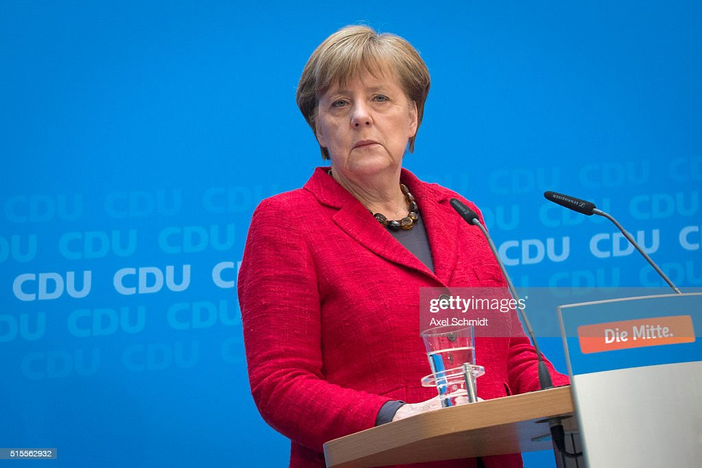 German Chancellor and Chairwoman of the German Christian Democrats (CDU) <a gi-track='captionPersonalityLinkClicked' href=/galleries/search?phrase=Angela+Merkel&family=editorial&specificpeople=202161 ng-click='$event.stopPropagation()'>Angela Merkel</a> prepares to speak to the media following elections in three German states on March 14, 2016 in Berlin, Germany. Voters went to the polls yesterday in Rhineland-Palatinate, Saxony-Anhalt and Baden-Wuerttemberg and the right-leaning populist Alternative fuer Deutschland (Alternative for Germany,AfD) scored double-digit results in all three, dealing a blow to Germany's established parties, especially to the CDU. Merkel's liberal immigration policy towards migrants and refugees was a major issue in the elections and the AfD aimed its campaign at Germans who are uneasy with so many newcomers.