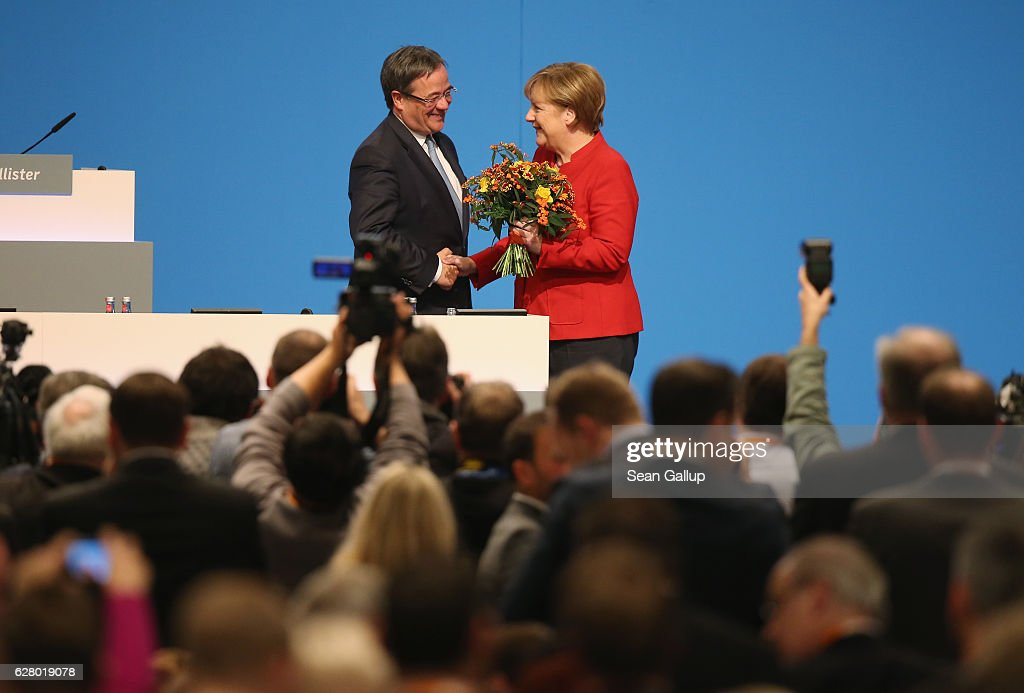 German Chancellor and Chairwoman of the German Christian Democrats (CDU) Angela Merkel is congratulated by Armin Laschet, head of the CDU in North Rhine-Westphalia, after she was re-elected by delegates as party chairwoman at the 29th federal congress of the CDU on December 6, 2016 in Essen, Germany. Approximately 1,000 CDU delegates are meeting to debate and vote on the party's course for next year following the recent announcement by Merkel that she will run for a fourth term as chancellor in federal elections scheduled for next September.