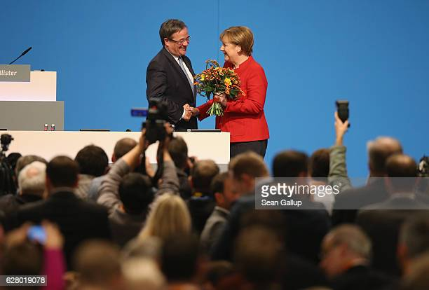 German Chancellor and Chairwoman of the German Christian Democrats Angela Merkel is congratulated by Armin Laschet head of the CDU in North...