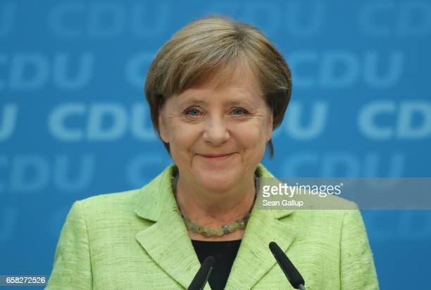 German Chancellor and Chairwoman of the German Christian Democrats Angela Merkel smiles while speaking to the media at CDU headquarters the day after...