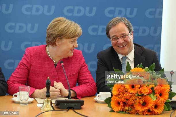 German Chancellor and Chairwoman of the German Christian Democrats Angela Merkel and CDU lead candidate in yesterday's state election in North...